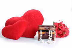 Heart, jewelry and flowers. Jewelry, flowers, heart, and smile on the pillow Royalty Free Stock Image