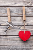 Heart and key hanging on a string Stock Images