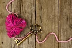 Heart and key on old wood Stock Photography