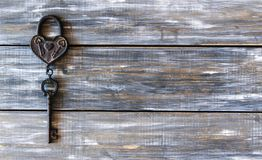Heart and key on wooden background Royalty Free Stock Photography