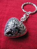Heart Keyring. An ornate, heart shaped keyring on red background Stock Photography