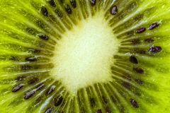 Heart of kiwi fruit with seeds close-up in a cut. Royalty Free Stock Photos