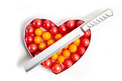 Heart and a knife. Cold heart,The knife on the top of the heart Royalty Free Stock Photos
