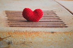 Heart knit with the old car bonnet. Heart knit with the old car bonnet in morning Royalty Free Stock Images