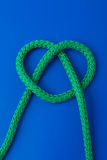 Heart from knot. Green heart from knot on dark blue background Royalty Free Stock Images