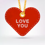 Heart. Label tag hanging on golden chain. Royalty Free Stock Images