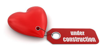 Heart with label Under Construction (clipping path included) Stock Photos