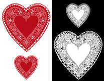 Heart Lace Doilies. Romantic red and white lace hearts with copy space for Valentines day, Mothers Day, anniversary, birthdays sewing, arts and crafts, scrap Royalty Free Stock Photo