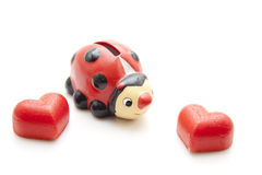 Heart and ladybug as a savings can Stock Photos