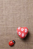 Heart and ladybug on the fabric Royalty Free Stock Image