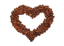 Heart laid out from coffee beans. Isolated on white background Stock Photos