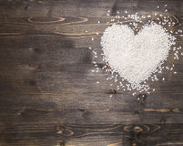 Heart, laid out rice on a rustic wooden background, top view, valentines day place text,frame Royalty Free Stock Photography
