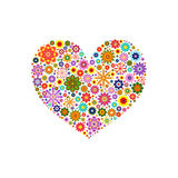 Heart laid out various flowers of different colors on white Stock Photo