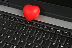 HEART ON LAPTOP. Red heart on laptop keyboard Royalty Free Stock Image