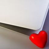 Heart and laptop Stock Images