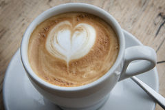 Heart Latte Froth. Cup of cappuccino on a wooden plank Stock Photo