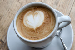 Heart Latte Froth. Cup of cappuccino on a wooden plank Stock Images