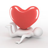 Heart on the laying person. Stock Photos