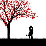 Heart leaves and kissing couple. Silhouette of kissing couple beside love tree Stock Photography