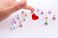 Heart between Letter cubes. On a white background Stock Photo
