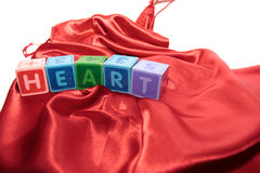 Heart letters on silk night dress Royalty Free Stock Photo