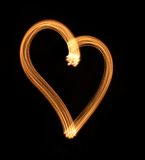 Heart from light on a black background. Stock Photography