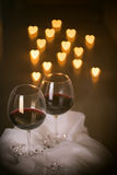 Heart lights and wine glasses Royalty Free Stock Photography