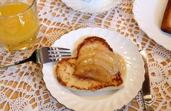 Heart-like toast with apple sauce. Hearty breakfast for darling - heart-like toast with apple sauce and orange juice on Stock Photo