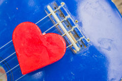 Heart on the line of  guitar. Royalty Free Stock Image