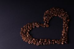 Heart lined with coffee beans stock photo