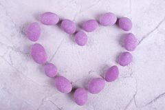 Heart, lined with pink candy. Heart shape from sweets. Sweet heart for Valentine`s Day royalty free stock images
