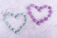 Heart, lined with pink and green candy. Sweet hearts for Valentine`s Day. Two Sweet Hearts royalty free stock photo