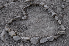 Heart is lined with stone on the ground. Royalty Free Stock Photography