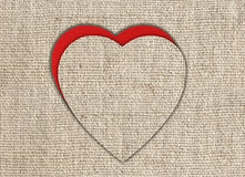 Heart of linen fabric with red substrate Stock Photo