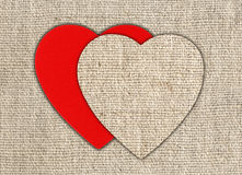 Heart of linen fabric with red substrate Royalty Free Stock Photos