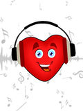 Heart listening music with headphone. Royalty Free Stock Image