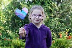 Heart. Little girl giving hand made heart Stock Photos