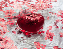 Heart and little hearts floating in the water. A big red heart. Lots of little red hearts. They all float in water Royalty Free Stock Image