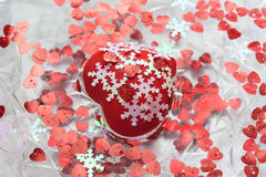 Heart, little hearts and snowflakes in water. A red heart. White snowflakes. A dish of water. Heart floats in water. Valentine`s day Royalty Free Stock Images