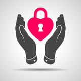 Heart lock shape icon in careful hands Stock Images