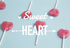 Heart lollipop on blue background.Minimal concept. Royalty Free Stock Image