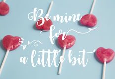 Heart lollipop on blue background.Minimal concept. Stock Photography