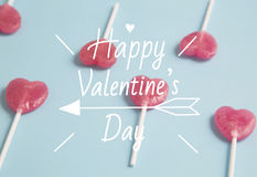Heart lollipop on blue background.Minimal concept. Stock Photo