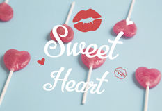 Heart lollipop on blue background.Minimal concept. Royalty Free Stock Photos