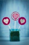 Heart lollipop in pot Stock Photos