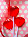 Heart lollipops on polka dots Royalty Free Stock Photography