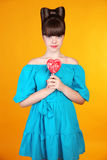 Heart Lollypop. Beautiful teen girl with colourful  lolli pop. F Stock Photos