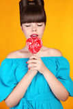 Heart Lollypop. Beautiful teen girl with colourful lolli pop. Fu Royalty Free Stock Image