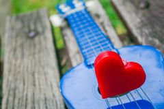 Heart on a lonely guitar. Stock Image
