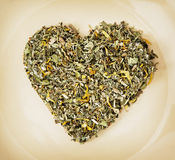 Heart of loose tea on the plate, love theme Royalty Free Stock Photography